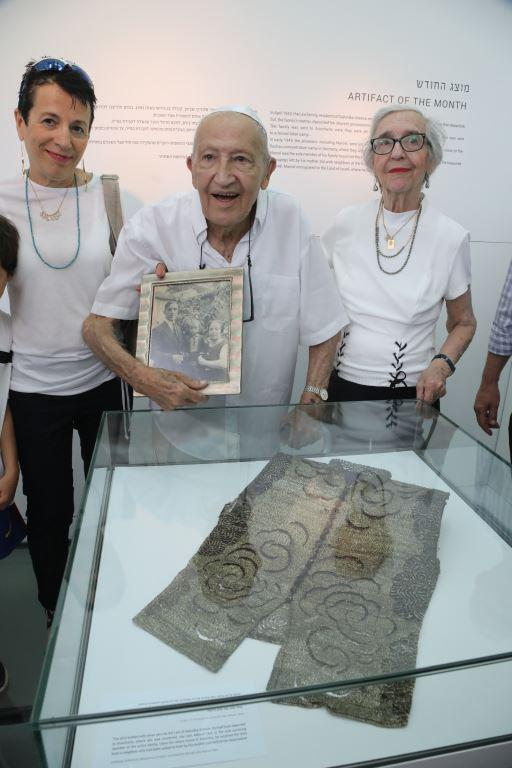 Marcel Levi holding picture of his family murdered in the Holocaust