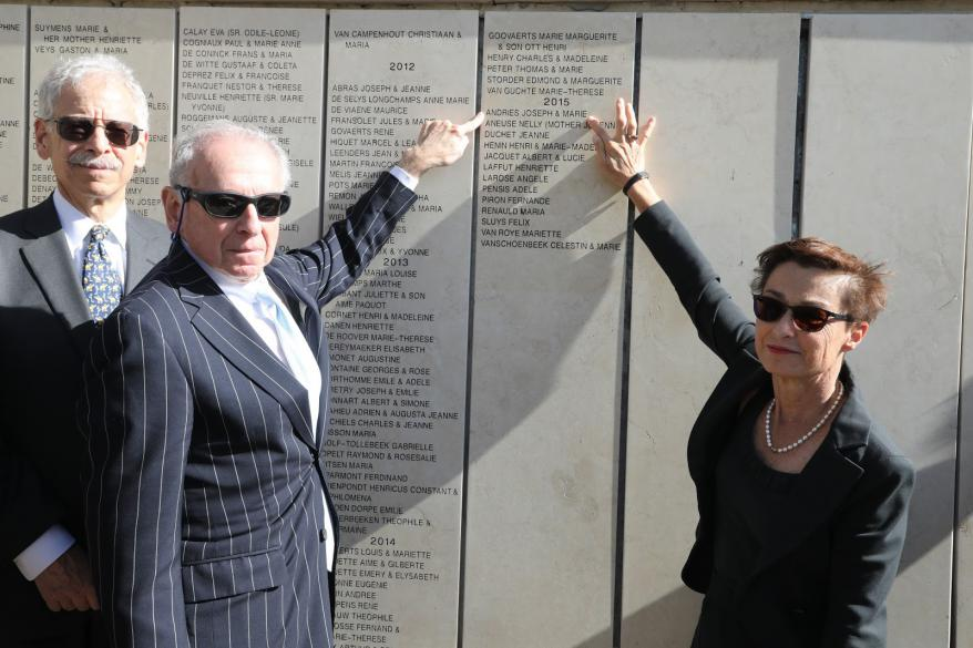 Dr. Francoise Rampelberg with Holocaust survivor Benno Gerson and Stefan Goldberg unveiling Righteous Marie and Joseph Andries's names of the Wall of Honor.