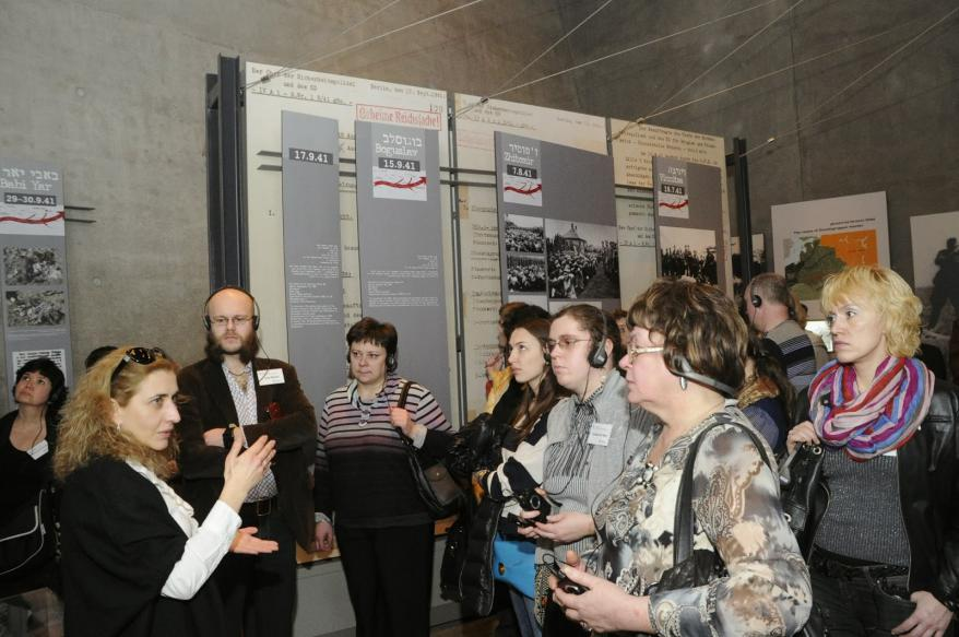 The group of museum directors, educators and researchers touring the Holocaust History Museum, Yad Vashem