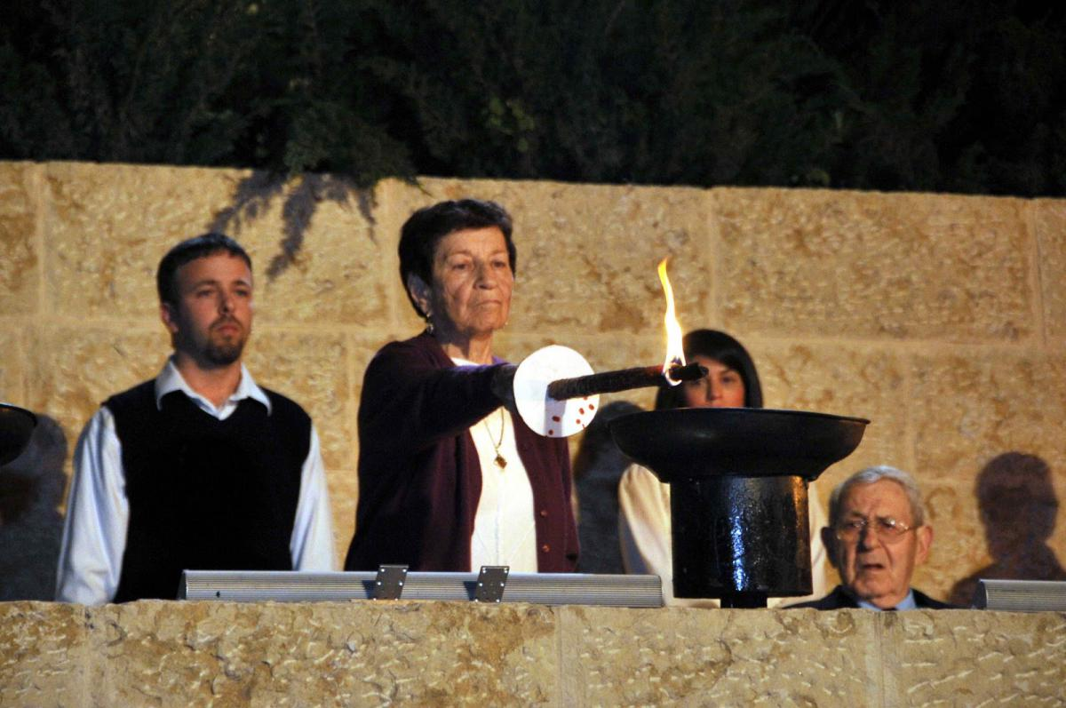 Holocaust survivor Dina Ostrover lighting a Memorial Torch at the Official  Holocaust Martyrs' and Heroes' Remembrance Day