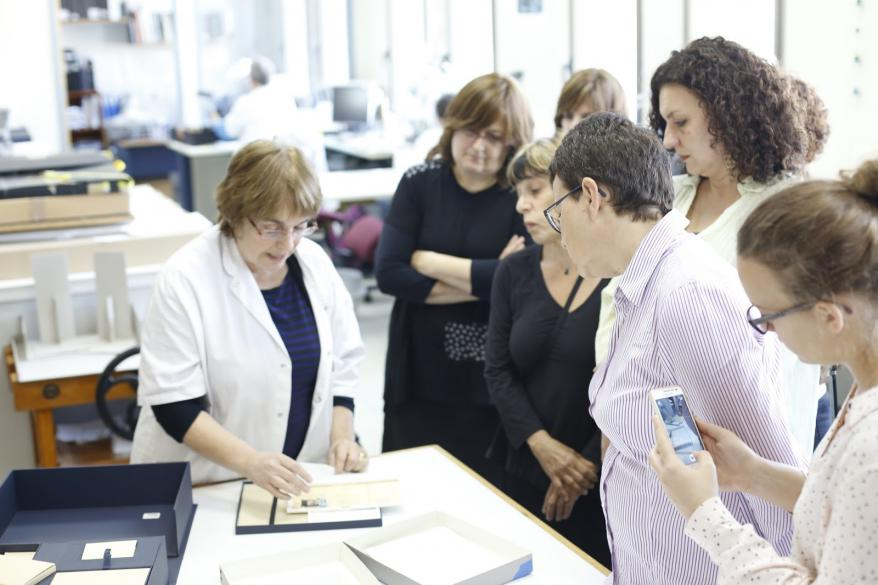 Varda Gross, Conservation Laboratory Director showing an  example of how Rywka's diary will be conserved