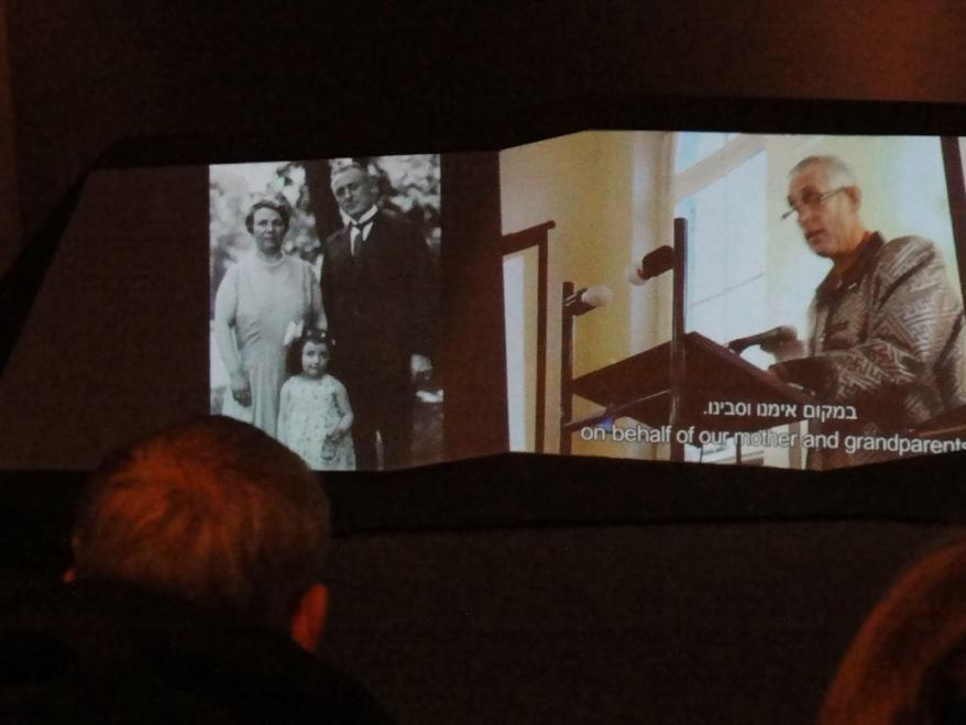 """Peter and Rineke Hetem watch the completed film for the first time in the """"I am my Brother's Keeper"""" exhibiton at Yad Vashem"""