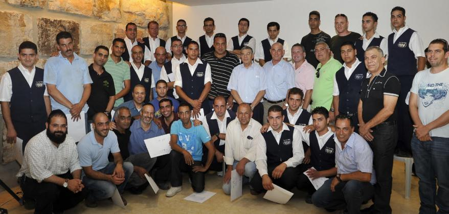 Certificates of appreciation presented to employees who fought fire at Yad Vashem