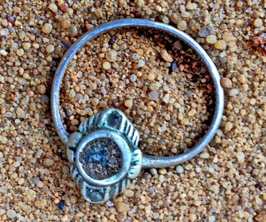 A woman's ring found in the ground at the location of the remains of the hut where victims undressed  before their murder