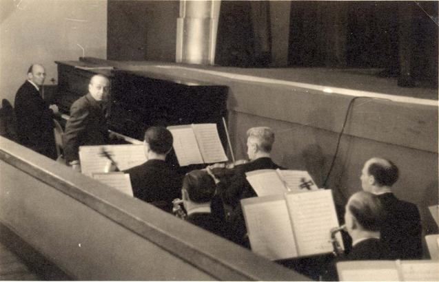 The orchestra in the Westerbork camp's theater. Willy Rosen  and Erich Ziegler are seen left on the pianos