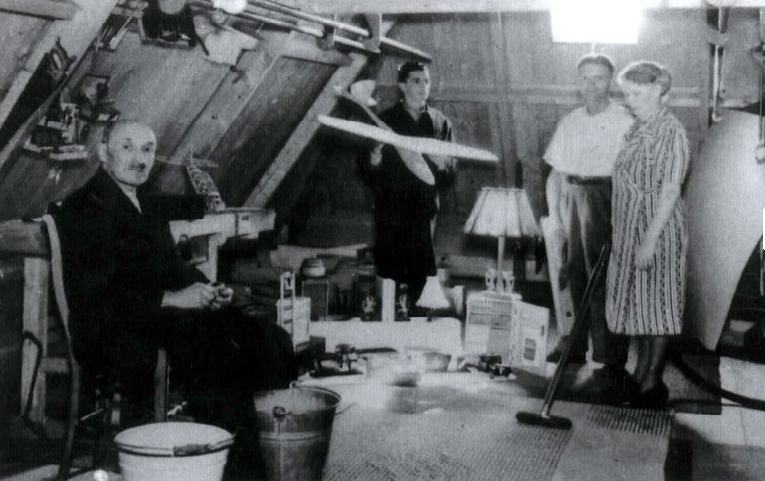 The workshop in the attic. From the left: Jakob. Behind his left shoulder is the edge of the workbench. Joachim-Max is holding the model plane