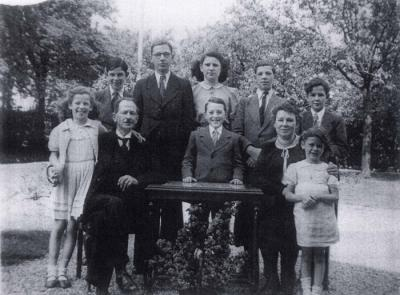 The Arnoldy family with their seven children and Maurice Sztum, 1943