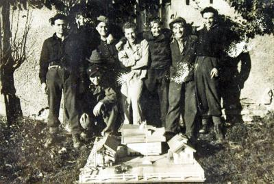 Some of the kibbutz members with the model of the Firstbach farm
