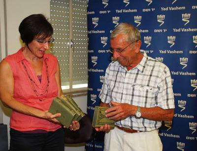 Mosher Hofstadter receiving his father's books at Yad Vashem, pictured with Cynthia Wroclawski, Manager of the Shoah Victims' Names Recovery Project