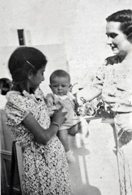 Zmira as a child in Libya, with the baby that she cared for