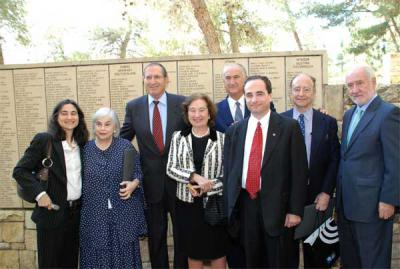 Propper family members and the Spanish ambassador to Israel (right) are photographed in the Garden of the Righteous Among the Nations, next to the Wall of Honor on which Propper's name is engraved