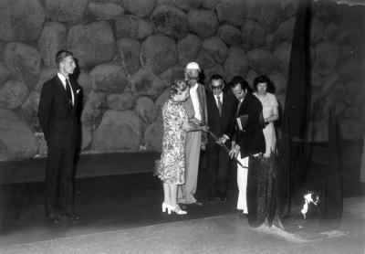 Miep Gies rekindles the flame in the Hall of Remembrance. Yad Vashem, May 6, 1977