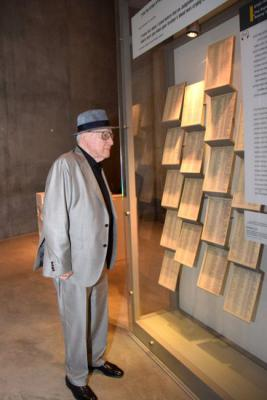 Branko Lustig looking at a facsimile of the original Schindler's List in Yad Vashem's Holocaust History Museum