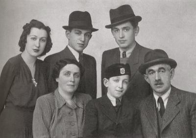 The Lowy family before the war. Seated are Hugo and Ilona, with their youngest son Frank between them. Standing right to left are Alex, John and Edith