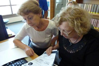 Rachel Vered with Leah Teichtel, Director of Reference and Information Services at Yad Vashem, reviewing archival information about her family