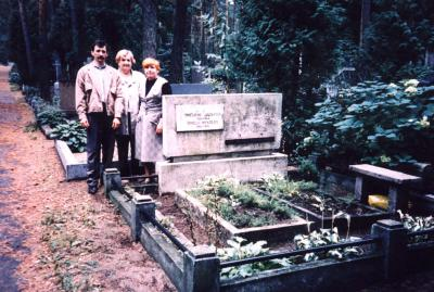 Survivors with the daughter of the rescuers at her parents grave