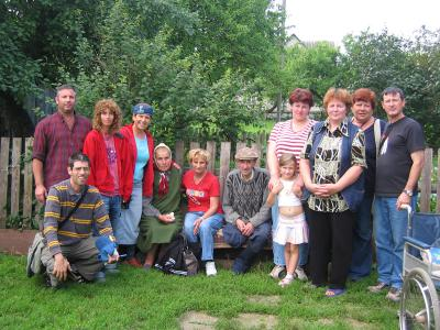 Survivor with her family and rescuer Janina with her family