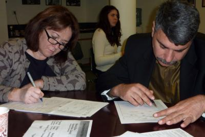 Dorit Korenblum and Gennadiy Koramblyum submitting Pages of Testimony for family members who were murdered in the Holocaust