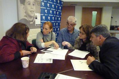 Bracha Fleischman, Rafi Korenblum, Dorit Korenblum, Gennadiy Gennadiy Koramblyum working with Yad Vashem Names Project staff to complete commemoration efforts