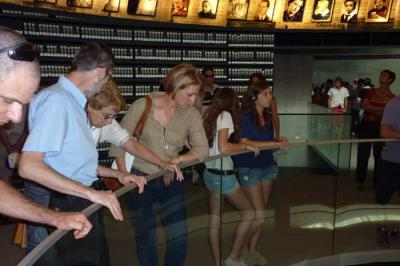 Rachel Vered pictured with her children Ofer and Michal visiting the Hall of Names at Yad Vashem