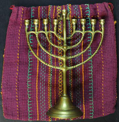 The cloth bag that Lore made as a child, and the Hanukkah menorah that she received from her parents when she was five years old