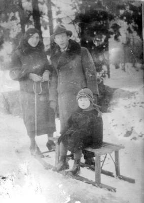 Benjamin on a sled with his parents Miriam and Mendel