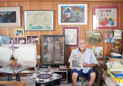 Marcel Levi in his home with the items that he donated to Yad Vashem