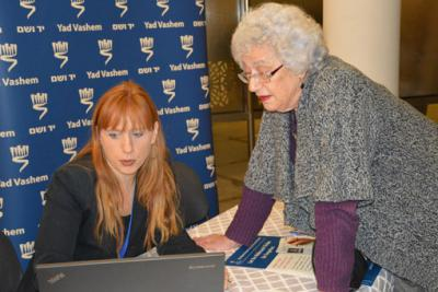 Assisting with searching the Central Database of Shoah Victims' Names at the 70 Days for 70 Years launch event in Jerusalem. (January 2015)
