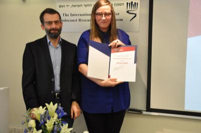 Miriam Schultz receiving a prize, with Dr. Arkadi Zeltser