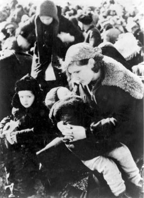 Lubny, Ukraine, 16.10.1941 - A mother with her two children awaiting, with other Jews from the town, at the assembly point, from where they were taken unknowingly to be murdered