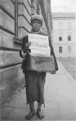 A Boy selling Newspapers in the Ghetto, Nowy Sacz, Poland