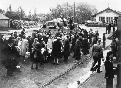 Jews from Koszez awaiting deportation train