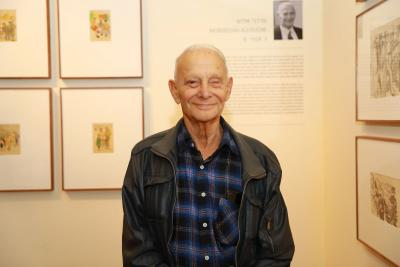 """Holocaust survivor Mordechai Allouche with his artwork at the opening of the """"New on Display"""" exhibit in the Holocaust Art Museum"""