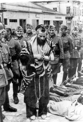 "German police unit publicly abuses and humiliates Rabbi Moshe Yitzchak Hagerman in Olkusz, Poland, on ""Bloody Wednesday"", July 31, 1940"