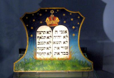 Torah scroll and a depiction of the Ten Commandments