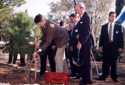 Varian Fry's son (left) and the U.S. Secretary of State Warren Christopher (second from right) plant a tree at Yad Vashem in Varian Fry's honor, 1996