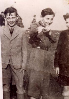 Adam Wnuczek, aged 12, with Two Other Boys, Krakow Ghetto, Poland, 1941