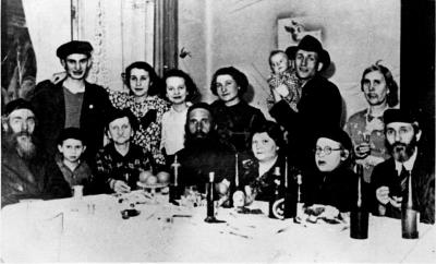 Poland, The Schwartz and Sylberberd families during a Purim meal, 1939