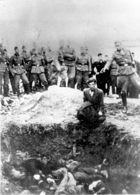 A member of the Waffen-SS shoots a Jew at a mass grave in Vinnitsa, Ukraine, July 1941