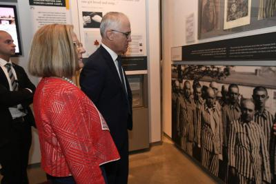 Prime Minster Turnbull and his wife Lucy studying a picture of prisoners at the Auschwitz-Birkenau extermination camp in the Holocaust History Museum