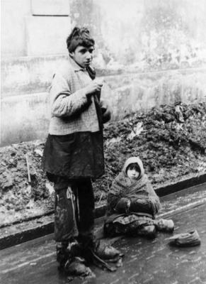 Warsaw, Poland, A young woman and a girl begging in the street