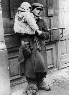 Warsaw, Poland, A youth holding a child in his arms