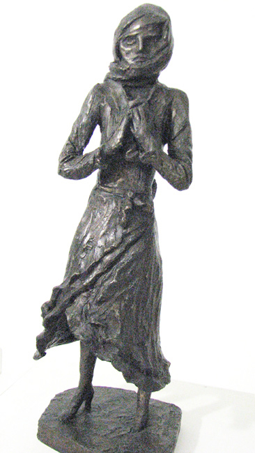 Half-crazy girl from the Warsaw ghetto holding her last treasure – a piece of bread (2002)