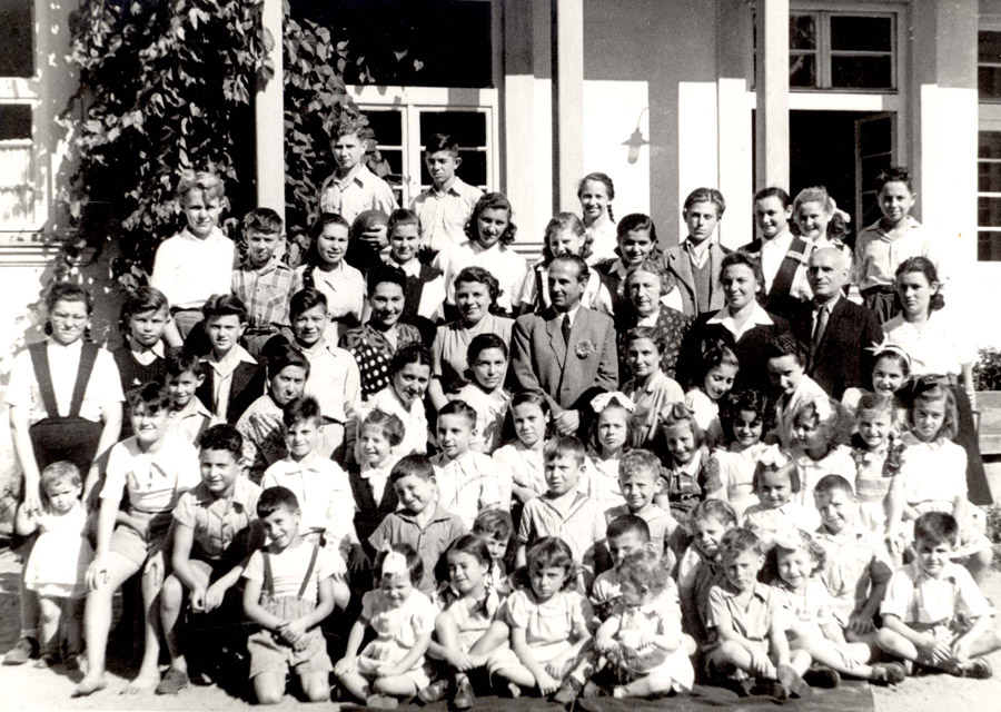 Group photograph of the children and staff of the home