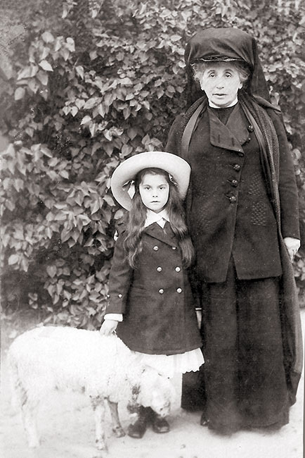 Young Sofka, with her grandmother and a lamb