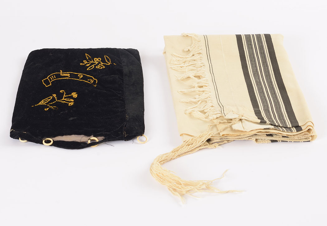 Solomon Krieser's <em>tallit</em> (prayer shawl) and <em>tallit</em> bag, which he sent to his daughters before being deported from Riversaltes to Auschwitz, where he was murdered.