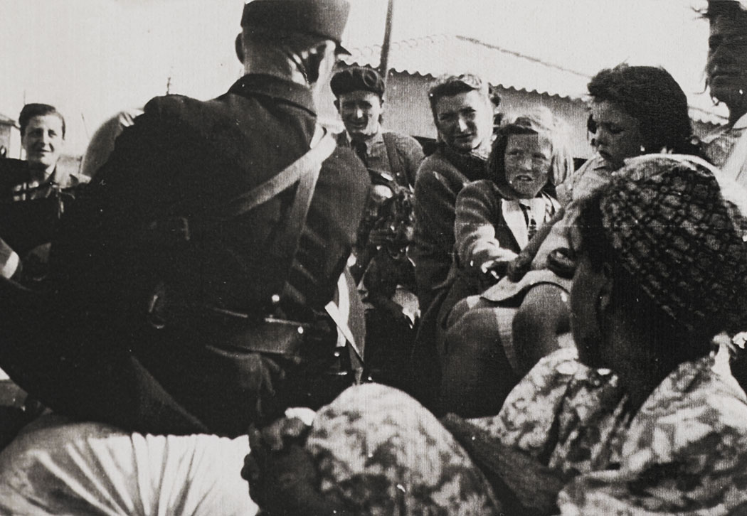 Hilda and Hannah Kreiser leaving Riversaltes on 5 September 1942, after Friedel Bohny-Reiter obtained the permit to return the sisters to Pringy.  The girls are on a truck leaving the camp, accompanied by a policeman whose back is to the photo.  The identity of the other adults in the photo is unknown, but they are presumed to be Jews from the camp. The photo was probably taken by Friedel.
