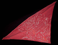 Strip of cloth left over from a Nazi flag, signed by women prisoners in Ravensbrück. Yehudit Aufrichtig embroidered their signatures