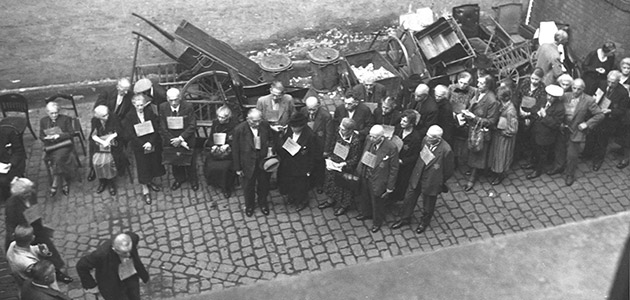 Jews standing in line in the courtyard of the Orthodox synagogue on Friedrichstrasse, waiting to register