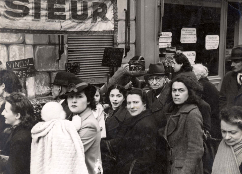 Paris, France, people in the market waiting in line to buy food, May 1941